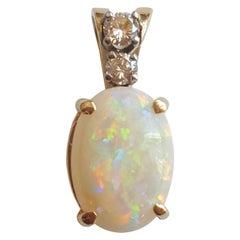 14 Karat Yellow Gold Oval Opal, Round Brilliant Diamond Three-Stone Pendant