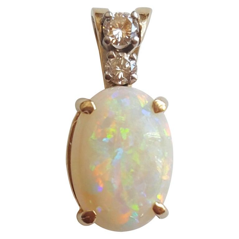 14 Karat Yellow Gold Oval Opal, Round Brilliant Diamond Three-Stone Pendant For Sale