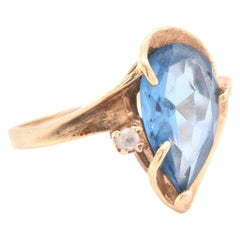 14 Karat Yellow Gold Pear Cut Blue Topaz and Diamond Ring