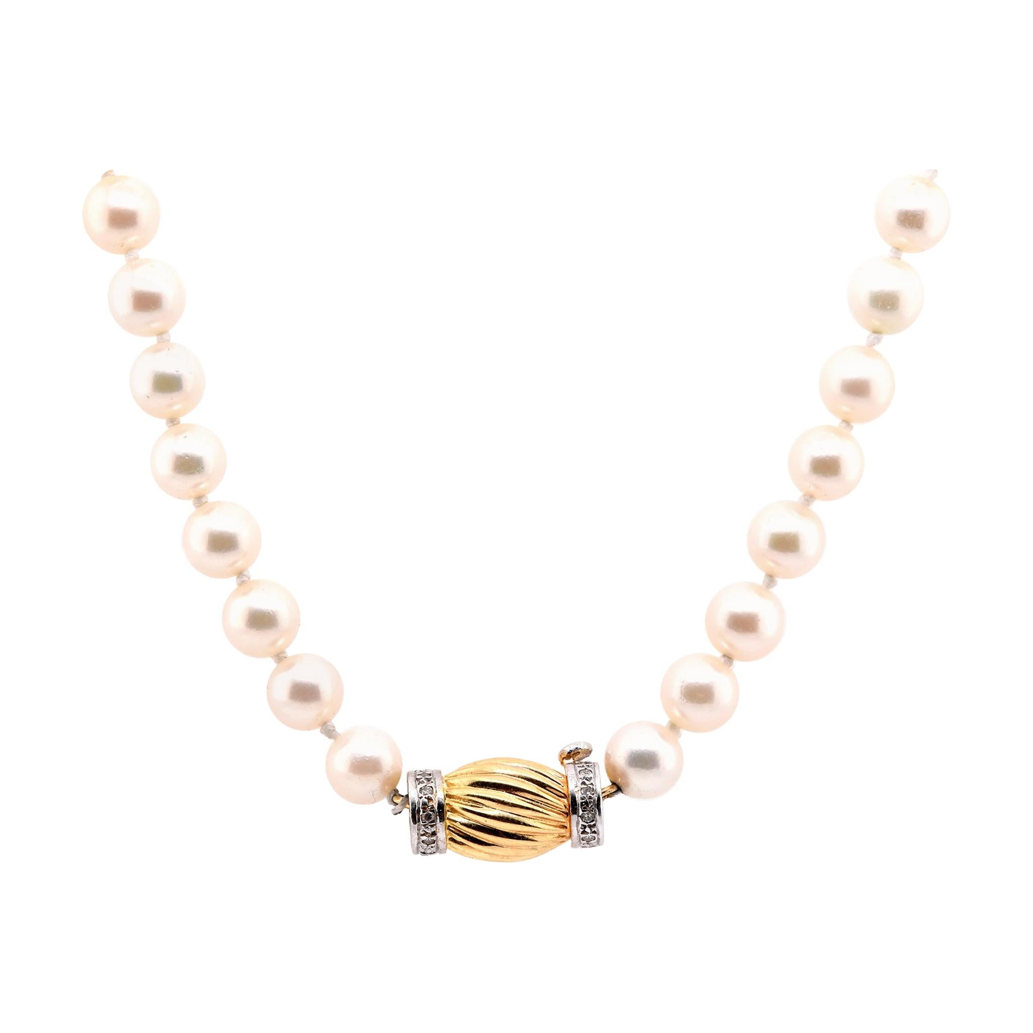 14 Karat Yellow Gold Pearl and Diamond Knotted Necklace