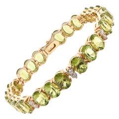 14 Karat Yellow Gold Peridot and Diamond Tennis Bracelet