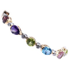 14 Karat Yellow Gold Peridot, Garnet, Pink Topaz, Blue Topaz, Amethyst, and Diam