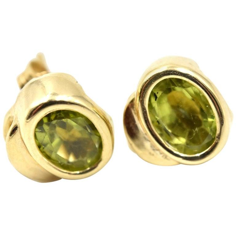 14 Karat Yellow Gold Peridot Stud Earrings For Sale