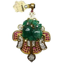 14 Karat Yellow Gold Pin/Pendant with Hand Craved Emerald, Diamonds and Rubies