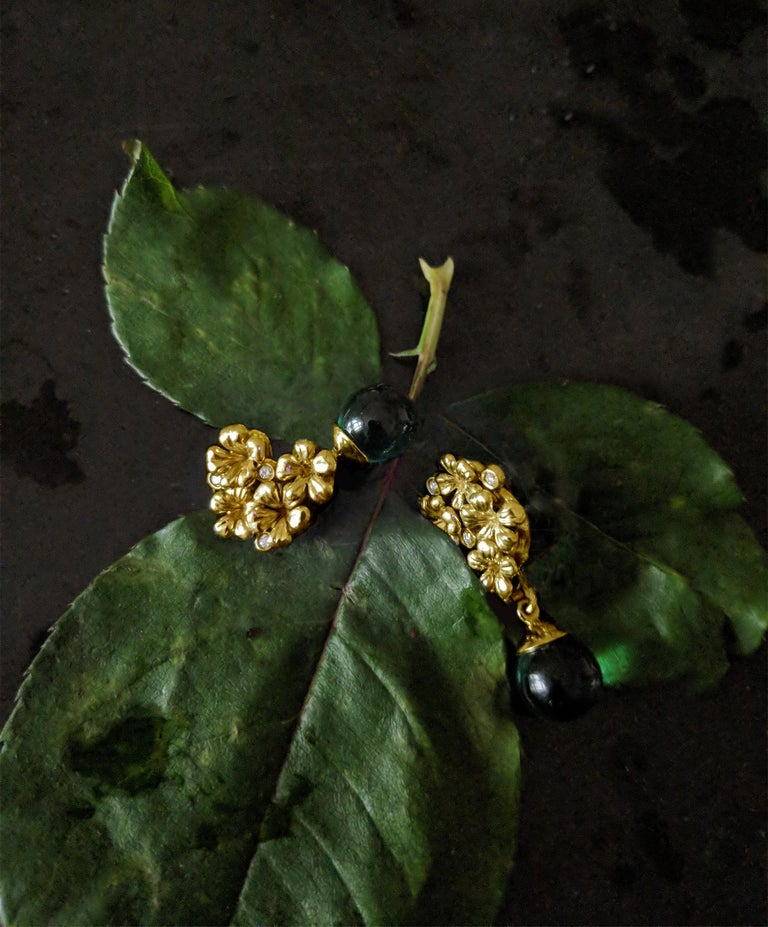 This is a piece from the contemporary jewellery collection, which was featured in Vogue UA review, and designed by the oil painter from Berlin Polya Medvedeva.  The clip-on earrings are made of 14 karat yellow gold, and encrusted with 6 round