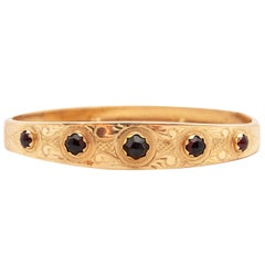 Contemporary Red Garnet Gemstone Engraved 14 Karat Yellow Gold Bangle Bracelet