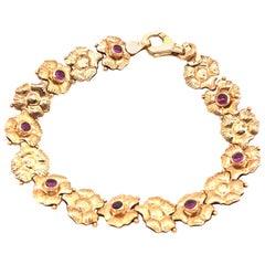 14 Karat Yellow Gold Reversible Garnet and Sapphire Bracelet