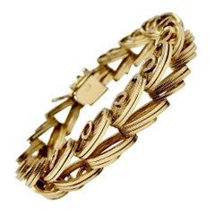 14 Karat Yellow Gold Ribbed Spiral Link Bracelet