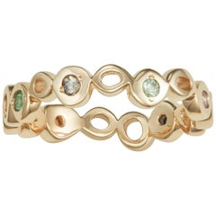 14 karat yellow gold ring band with multi color sapphires