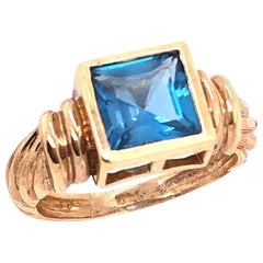 14 Karat Yellow Gold Ring with Solitaire Center Aquamarine Emerald Cut
