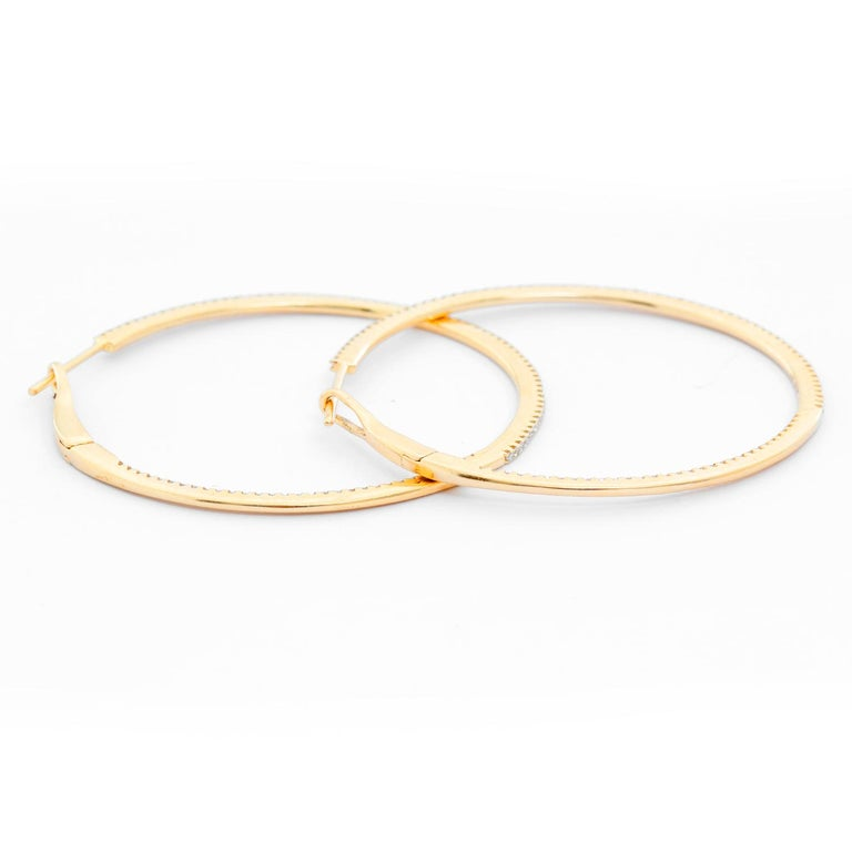 14K Yellow Gold Round Inside Out Hoops - Stunning and delicate 14K Yellow Gold hoops. Measuring 1 1/2  in. in diameter with .55 cts of diamonds. Clarity SI. Color GH. Total weight 4.6 grams.