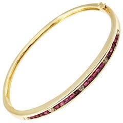 14 Karat Yellow Gold Ruby and Diamond Bangle Bracelet