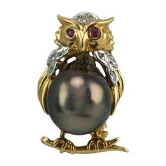 14 Karat Yellow Gold Ruby Eyed Owl Pin with Tahitian South Sea Pearl & Diamonds