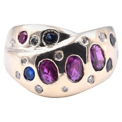 14 Karat Yellow Gold Ruby, Sapphire, Emerald, and Diamond Crossover Ring
