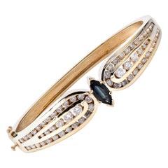 14 Karat Yellow Gold Sapphire and Diamond Bangle Bracelet
