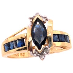 14 Karat Yellow Gold Sapphire Ring with Diamond Accents
