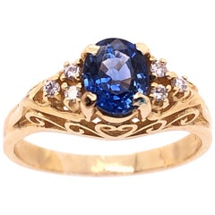 14 Karat Yellow Gold Sapphire Solitaire Ring with Side Diamond Accents