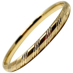 14 Karat Yellow Gold Satin Finish Diamond Cut Bangle Bracelet