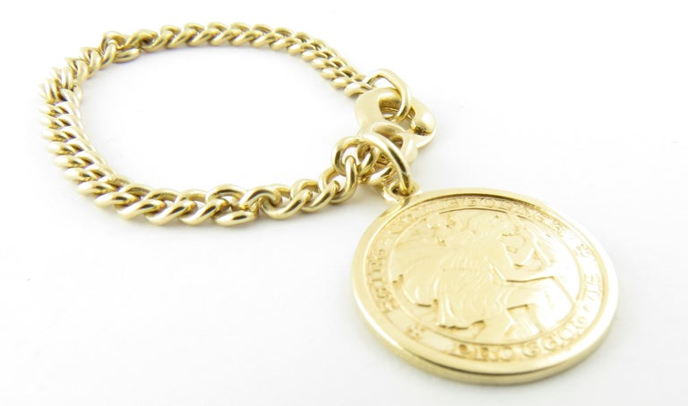 Vintage 14 Karat Yellow Gold. St. Christopher Watch Fob  This elegant watch fob features a beautifully detailed St. Christopher medal crafted in classic 14K yellow gold.  Size: 19 mm (medal)  80 mm (chain)  Weight: 5.6 dwt. / 8.6 gr.  Stamped: