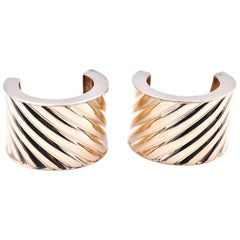 "14 Karat Yellow Gold Swirl Huggie Earrings Signed ""AW"""