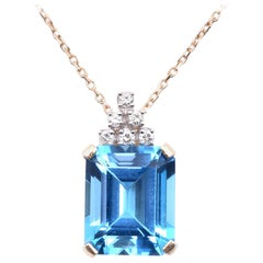 14 Karat Yellow Gold Swiss Blue Topaz and Diamond Pendant