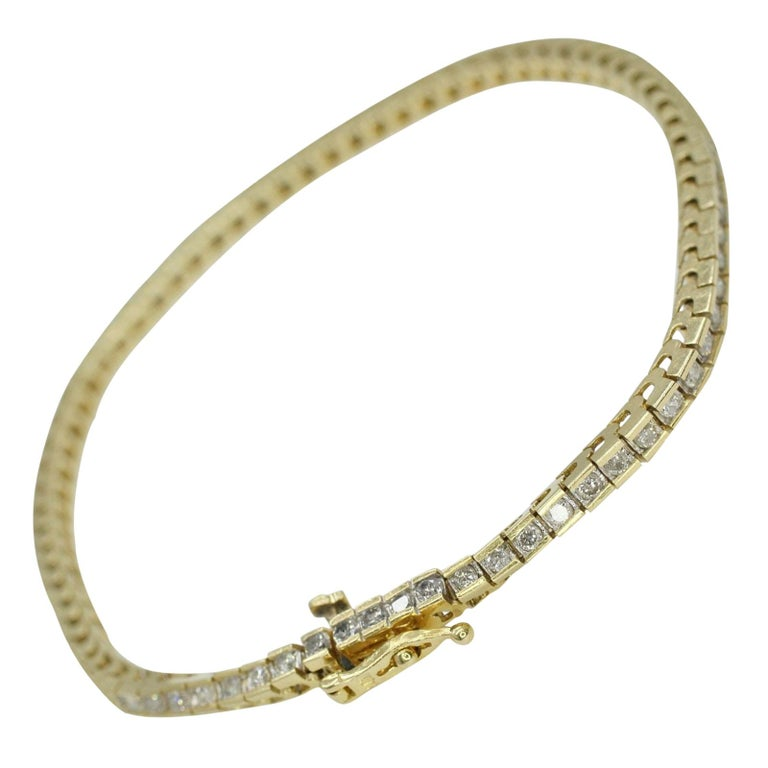 14 Karat Yellow Gold Tennis Bracelet 2.10 Carat Total Weight For Sale