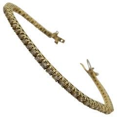 14 Karat Yellow Gold Tennis Bracelet with Round Brilliant Diamonds 3.24 Carat