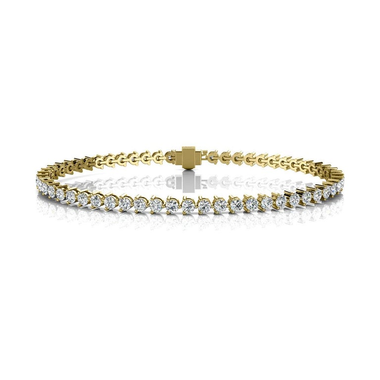 A timeless three prongs diamonds tennis bracelet. Experience the Difference!  Product details:   Center Gemstone Type: NATURAL DIAMOND Center Gemstone Color: WHITE Center Gemstone Shape: ROUND Center Diamond Carat Weight: 3 Metal: 14K Yellow
