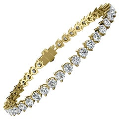 14 Karat Yellow Gold Three Prongs Diamond Tennis Bracelet '7 Carat'