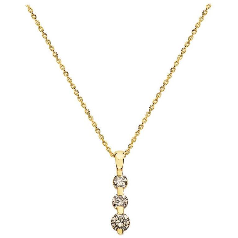 14 Karat Yellow Gold Three-Stone Diamond Pendant Necklace For Sale