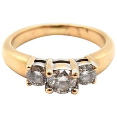 14 Karat Yellow Gold Three-Stone Round Brilliant Cut Diamond Ring