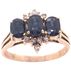 14 Karat Yellow Gold Three-Stone Sapphire Ring with Diamond Accents