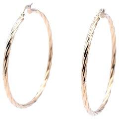 14 Karat Yellow Gold Twist Hoop Earrings