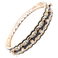 14 Karat Yellow Gold Vintage Diamond and Black Enamel Hinged Bangle Bracelet