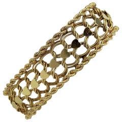 14 Karat Yellow Gold Vintage Spiral Rope Heart Charm Bracelet