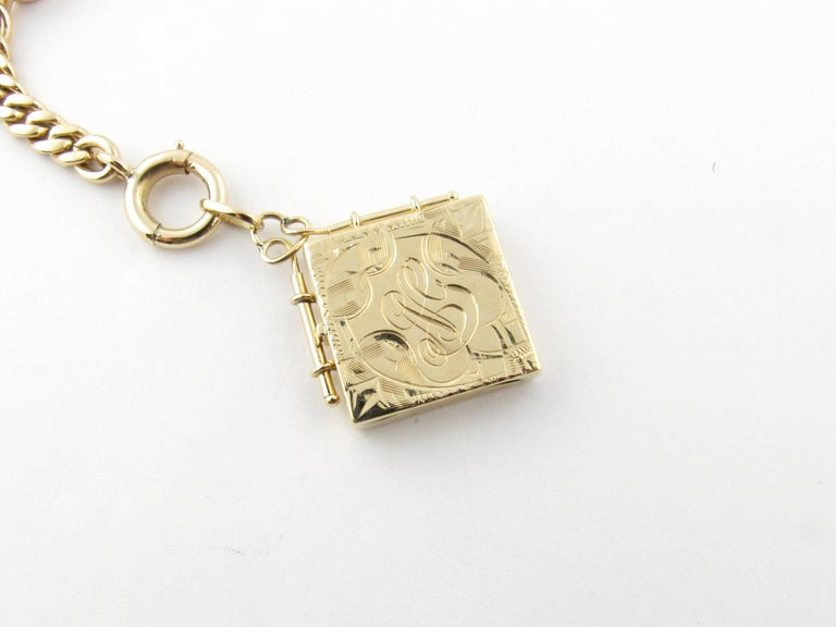 Vintage 14 Karat Yellow Gold Watch Fob Locket  This lovely watch fob features a monogrammed locket (