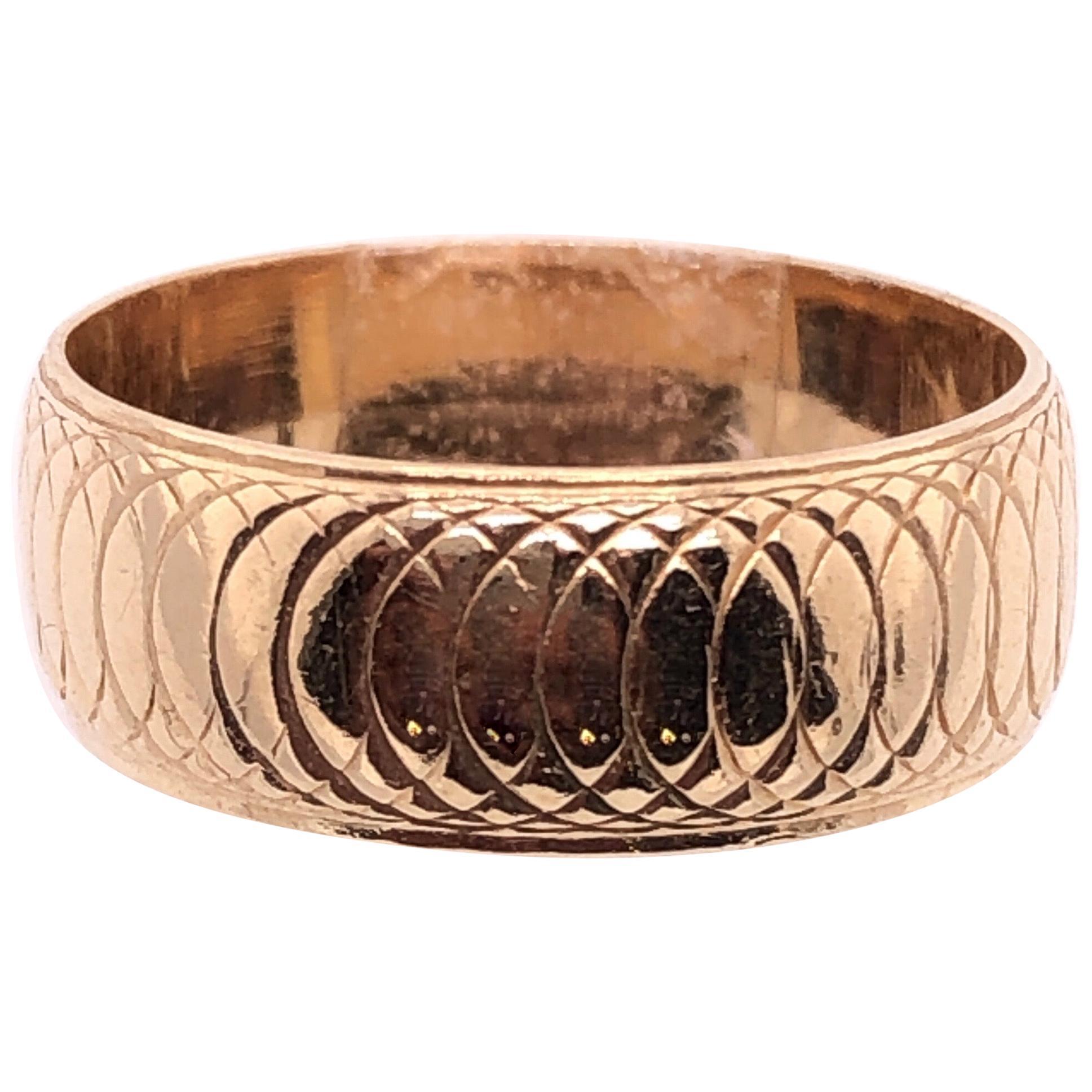 14 Karat Yellow Gold Wedding Ring / Bridal Band Swirl Design