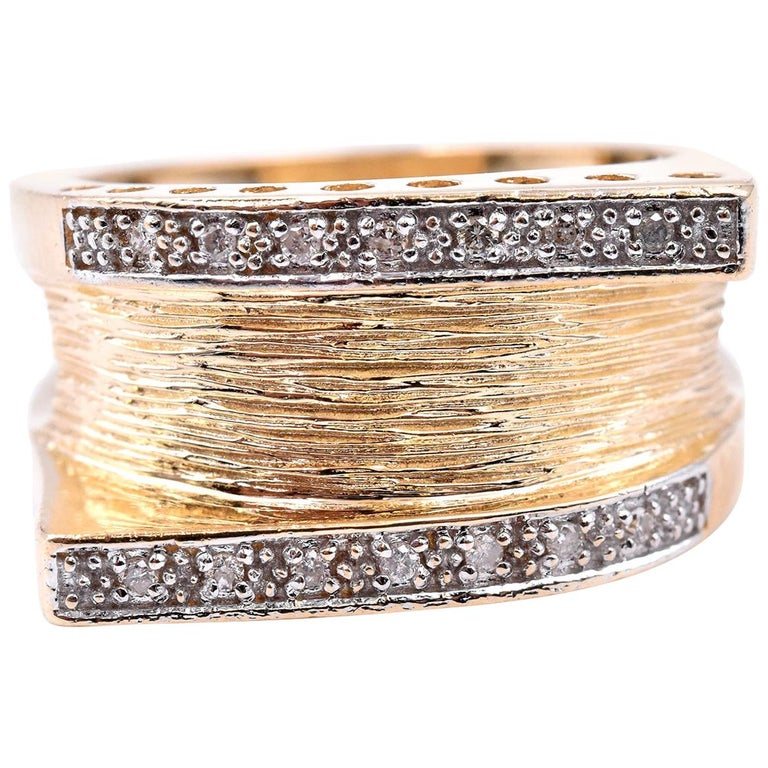 Designer: custom Material: 14K yellow gold Diamonds: 14 round brilliant cut = 0.07cttw Color: I Clarity: SI2 Ring Size: 7 (Please allow up to two additional business days for sizing requests) Dimensions: ring top measures 11.7mm wide  Weight: 6.73