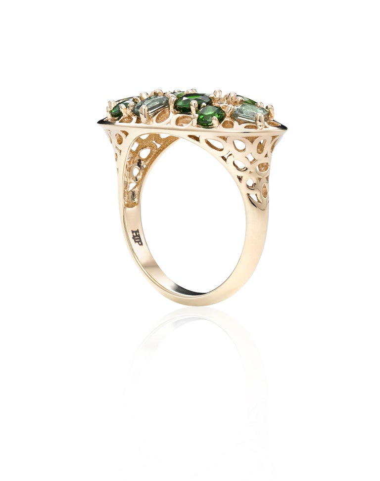 Prong set Green Sapphires and Chrome Diopside stones scattered within Hi June Parker's signature intricate open work of organic circular motifs are captured in this Statement ring created to be worn with a cocktail dress, strong suit or your
