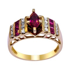 14 Karat Yellow Gold with Diamond and Ruby C.Z Ladies Ring