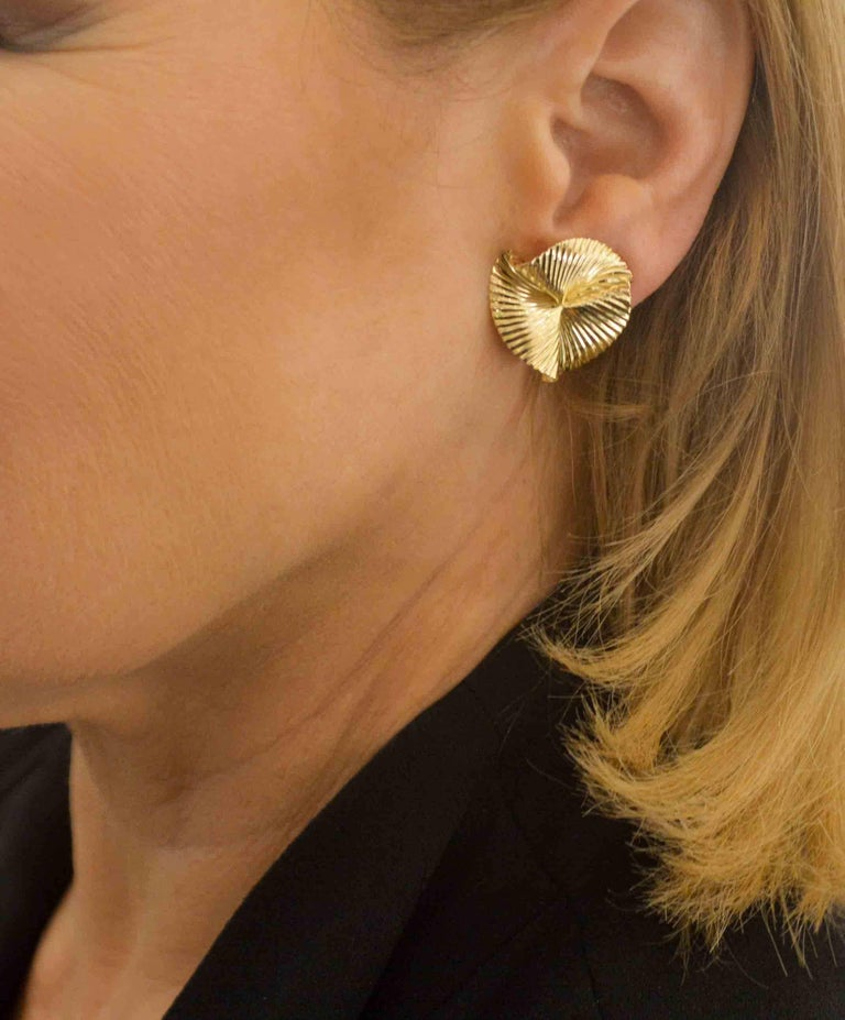 Modern 14 Karat Yellow Swirl Clip Back Earrings For Sale