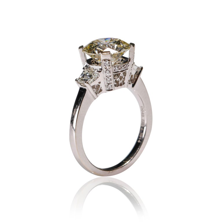 14 Karat White Gold 4 Carat Round Diamond Solitaire Engagement Ring by Natalie K  Triple cluster halo diamond engagement ring. Fashioned in platinum, is the perfect way to say