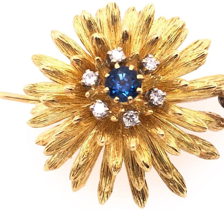 14 Karat Yellow Gold Brooch Pin Center Sapphire and Surrounding Diamonds 0.50 total diamond weight. 19.54 grams total weight.