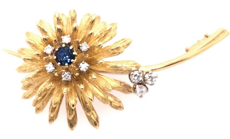 Round Cut 14 Karat Yellow Gold Brooch Pin Center Sapphire and Surrounding Diamonds For Sale