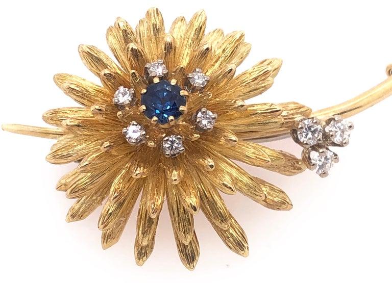 Women's or Men's 14 Karat Yellow Gold Brooch Pin Center Sapphire and Surrounding Diamonds For Sale