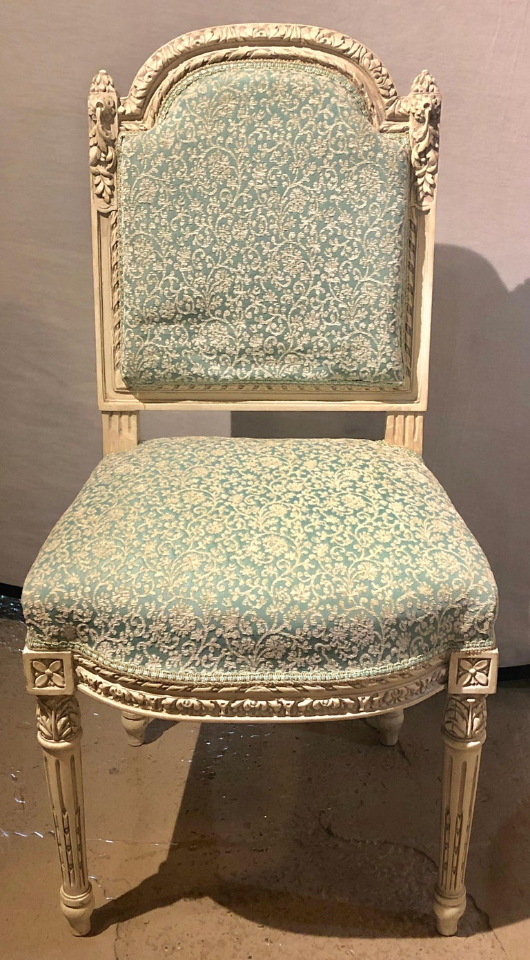 14 Swedish Louis XVI style dining / side chairs painted carved frames new fabric. This stunning set of 24 dining chairs, 12 available here and 12 in a different fabric, have been fully refinished and each are done in a fine new fabric. Each having a