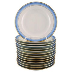 14 Royal Copenhagen Plates in Hand Painted Porcelain, Blue Border with Gold