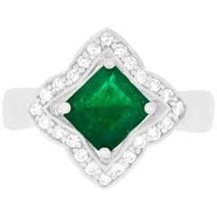 1.40 Carat Cushion Cut Emerald and 0.29 Carat White Diamond Ring