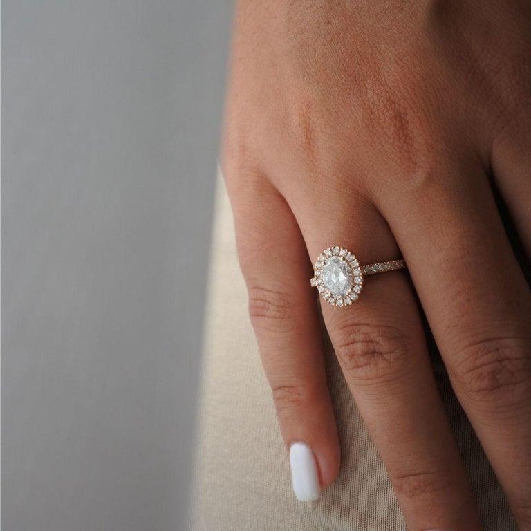 Art Deco 1.40 Carat EGL Certified Oval Shaped Diamond Halo Ring in 14 Karat Rose Gold For Sale