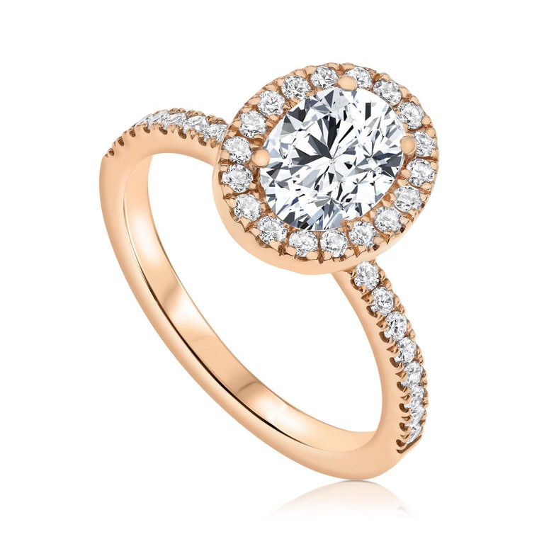 1.40 Carat EGL Certified Oval Shaped Diamond Halo Ring in 14 Karat Rose Gold   Shlomit Rogel's halo diamond ring is a gorgeous engagement ringset with all naturalshiny excellentcut diamonds. Center diamond is oval shaped 1.00 carat EGL certified